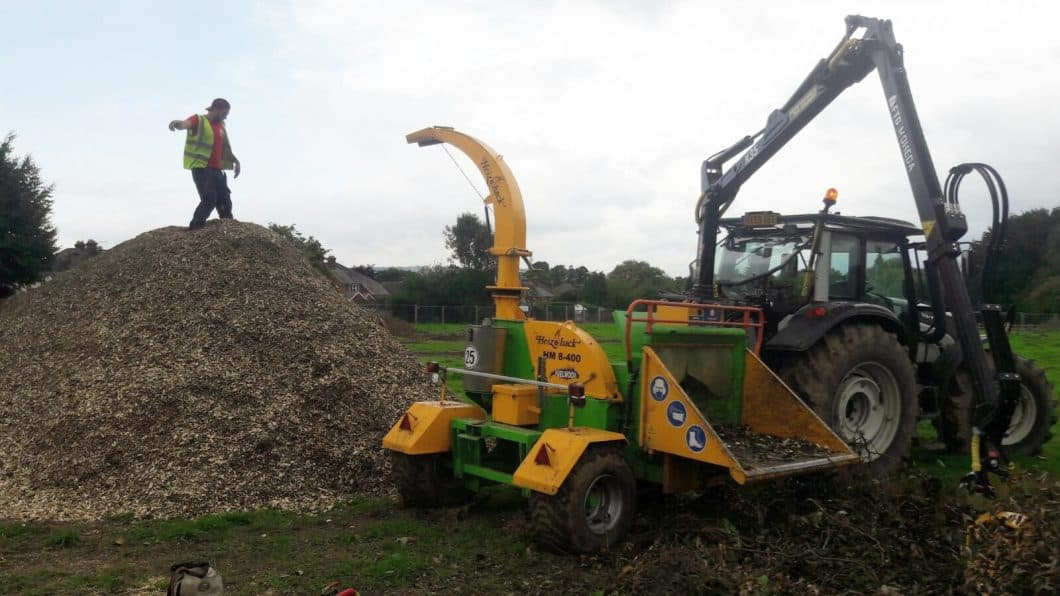 Crane Fed Chipping at a Site Clearance
