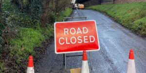 A road closed sign placed by oxford tree surgeons